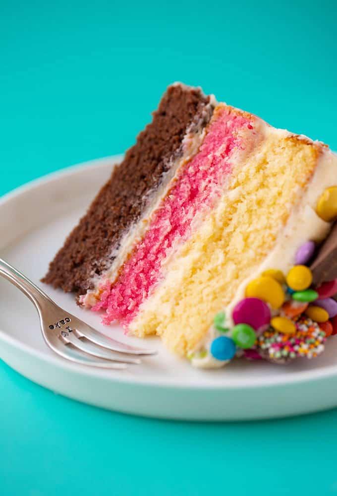 A close up of a Neapolitan Layer Cake