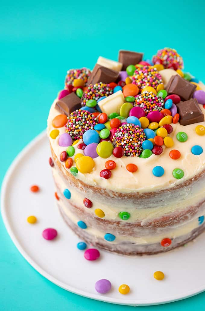 A birthday party cake covered in colourful candy