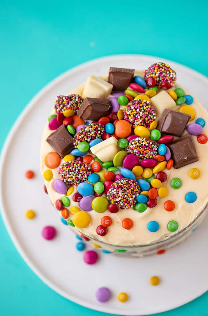 Top view of a cake decorated with chocolate and candy