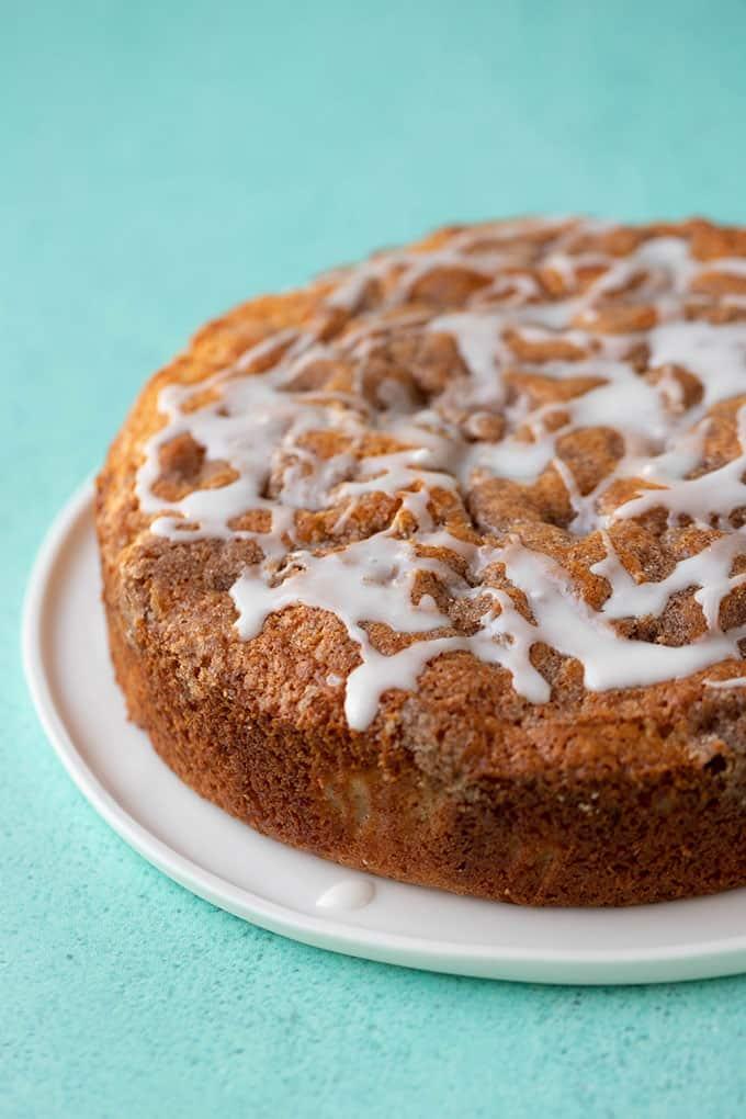A homemade Apple Cinnamon Cake on a white plate