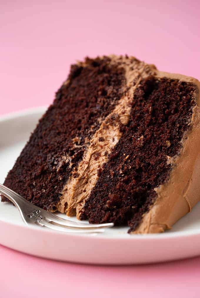 A close up of a big slice of chocolate cake