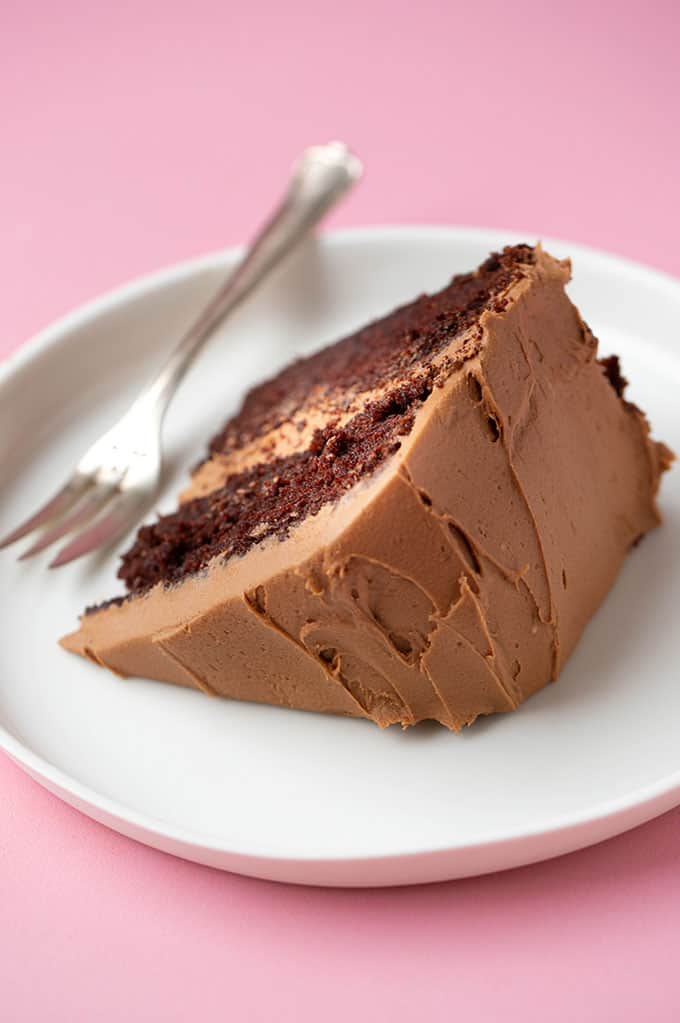 A piece of Chocolate Fudge Cake on a white plate