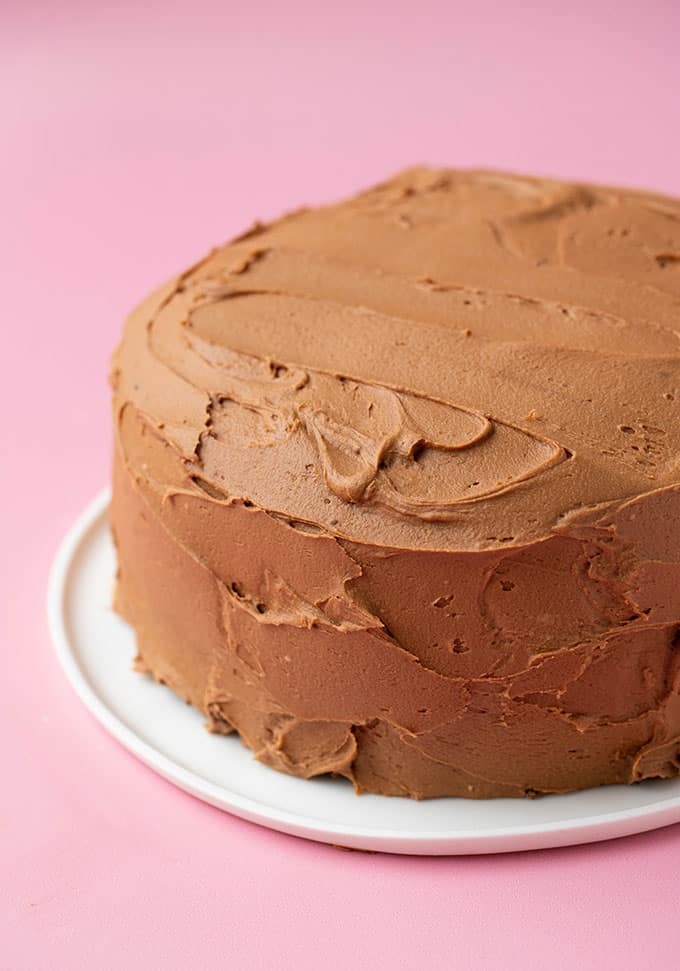A homemade chocolate cake covered in chocolate fudge frosting.