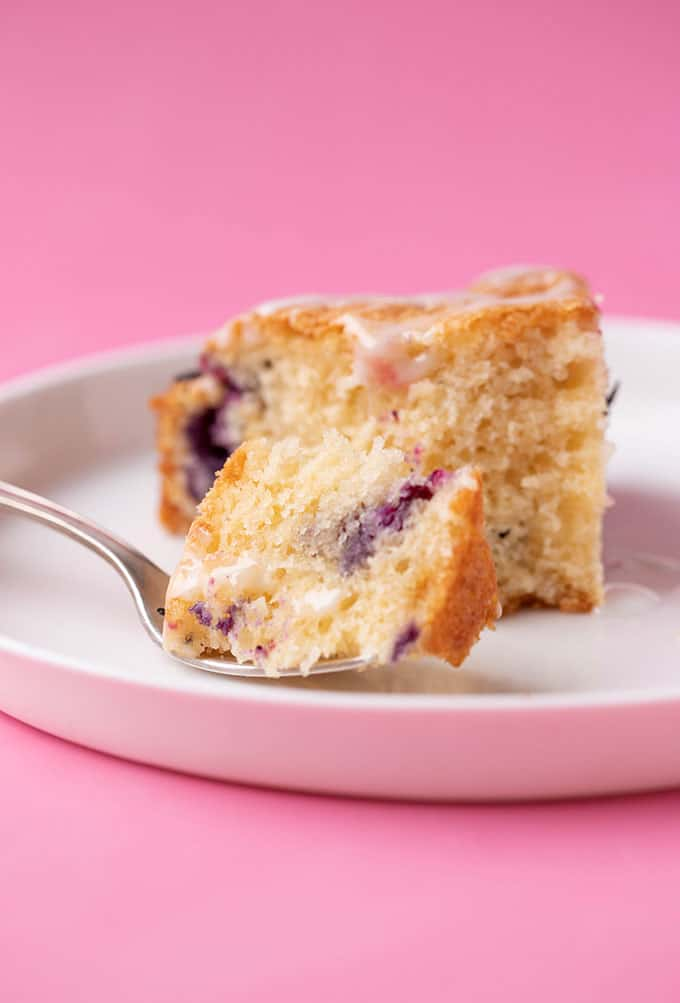 A slice of Blueberry Cake with a bite take out of it