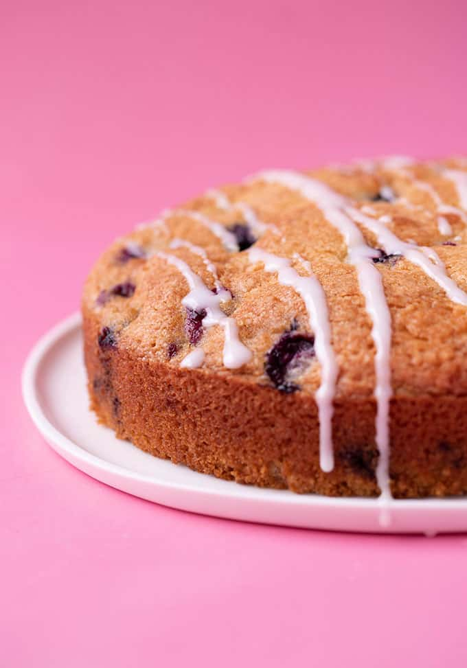 A whole Dairy Free Blueberry Cake with a drizzle of lemon