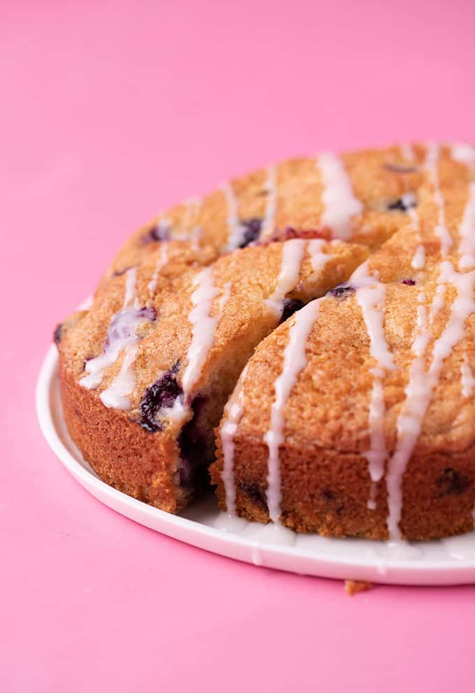 A Blueberry Cake with a slice taken out of it