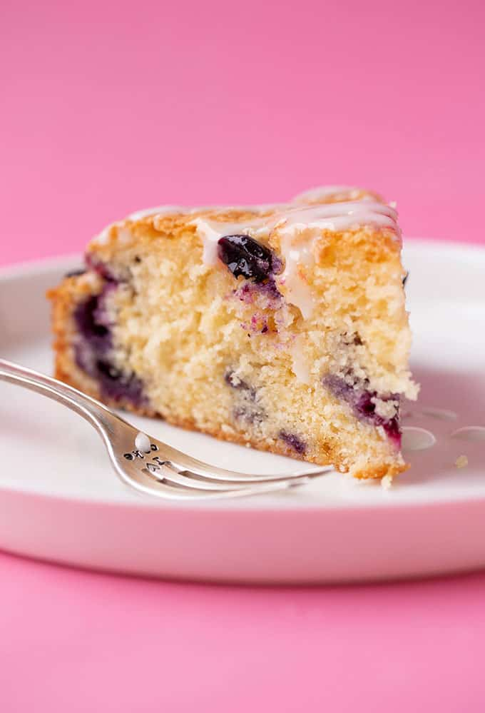 A slice of Dairy Free Blueberry Cake on a white plate