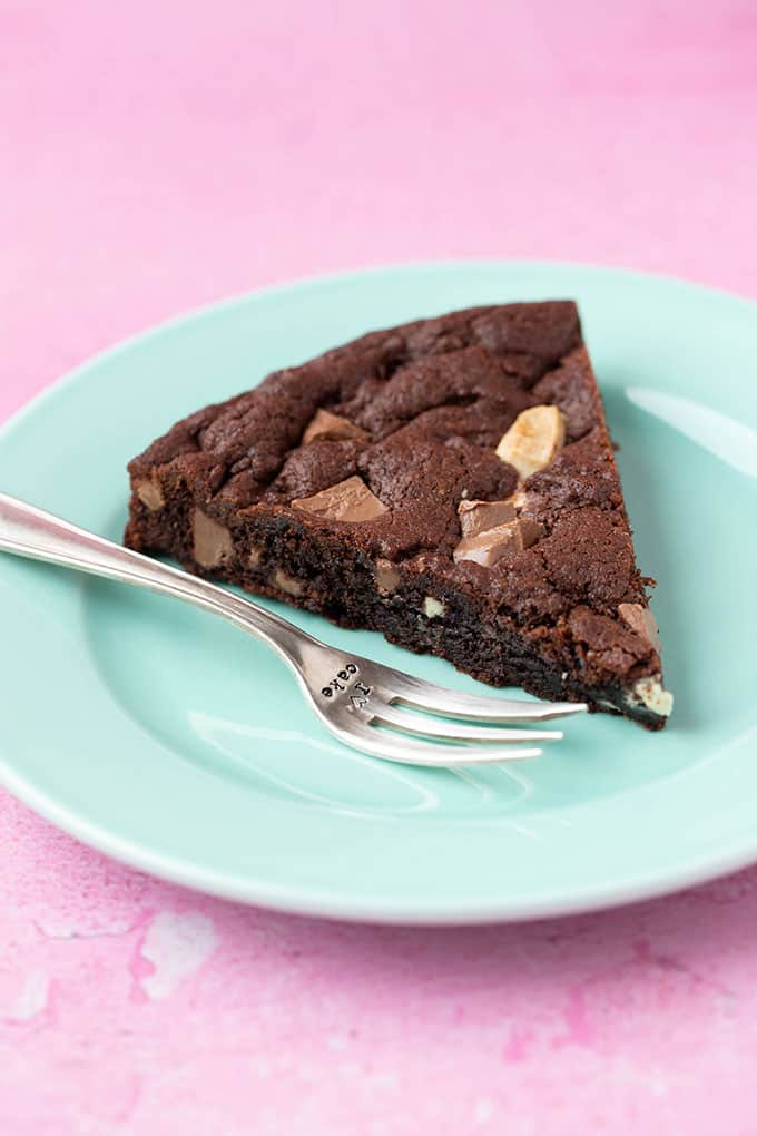 A slice of Triple Chocolate Cookie Cake on a green plate