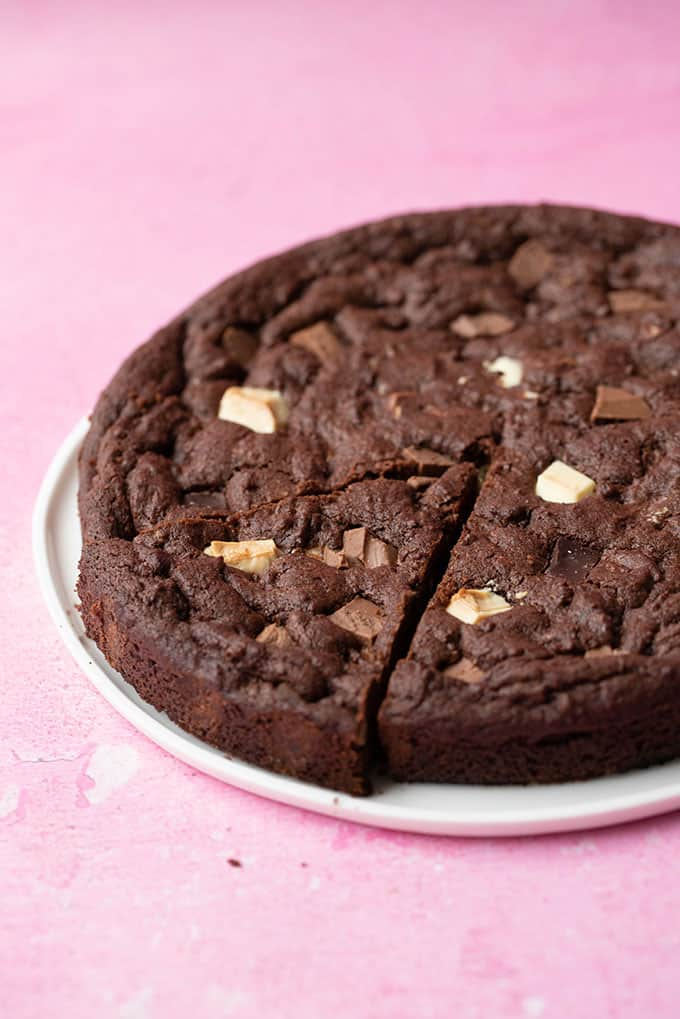 A white plate with a giant Triple Chocolate Cookie