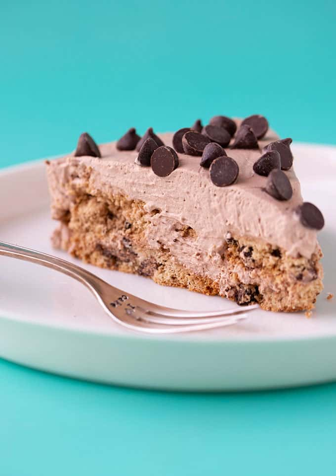 A slice of Chocolate Chip Cookie Icebox Cake on a white plate