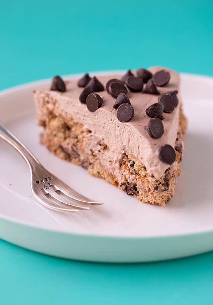 A piece of Chocolate Chip Cookie Icebox Cake on a blue background