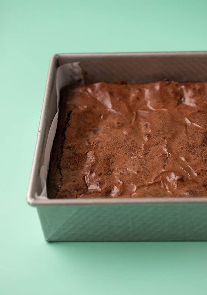 A crinkly topped brownie still in a cake pan