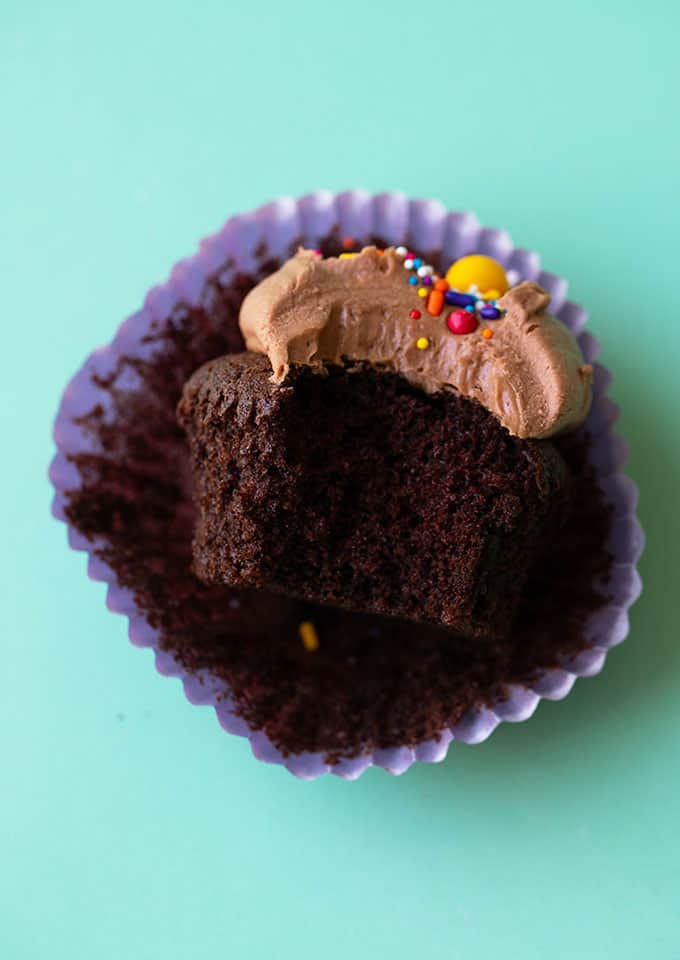 A chocolate cupcake with a bite taken out of it