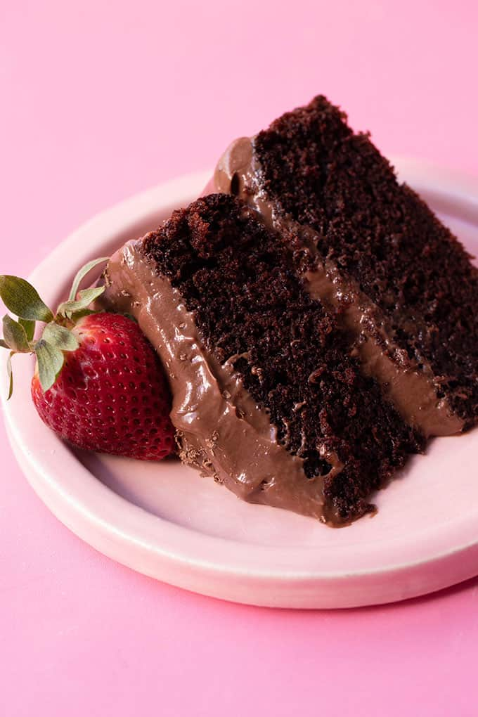 A piece of chocolate cake with a strawberry on top