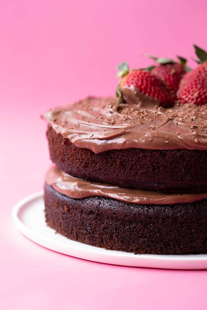 A two layer chocolate cake covered in chocolate frosting