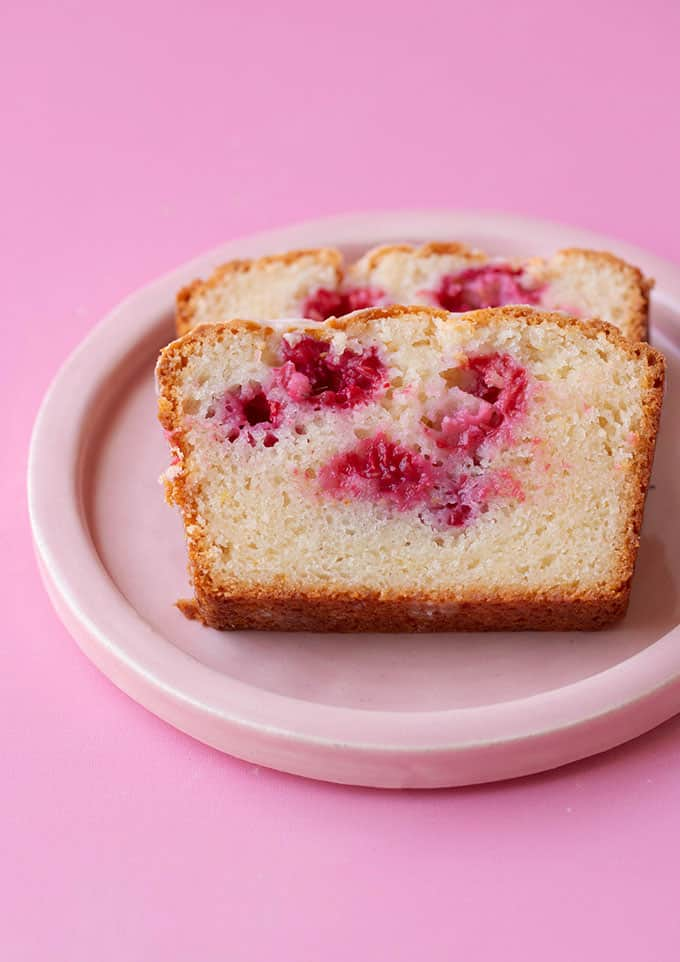 A pink plate with two pieces of Lemon Loaf