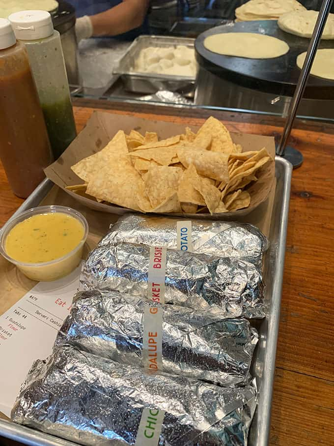 Tacos and corn chips at a restaurant table