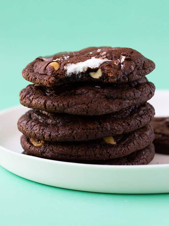 A stack of cookies on a green background