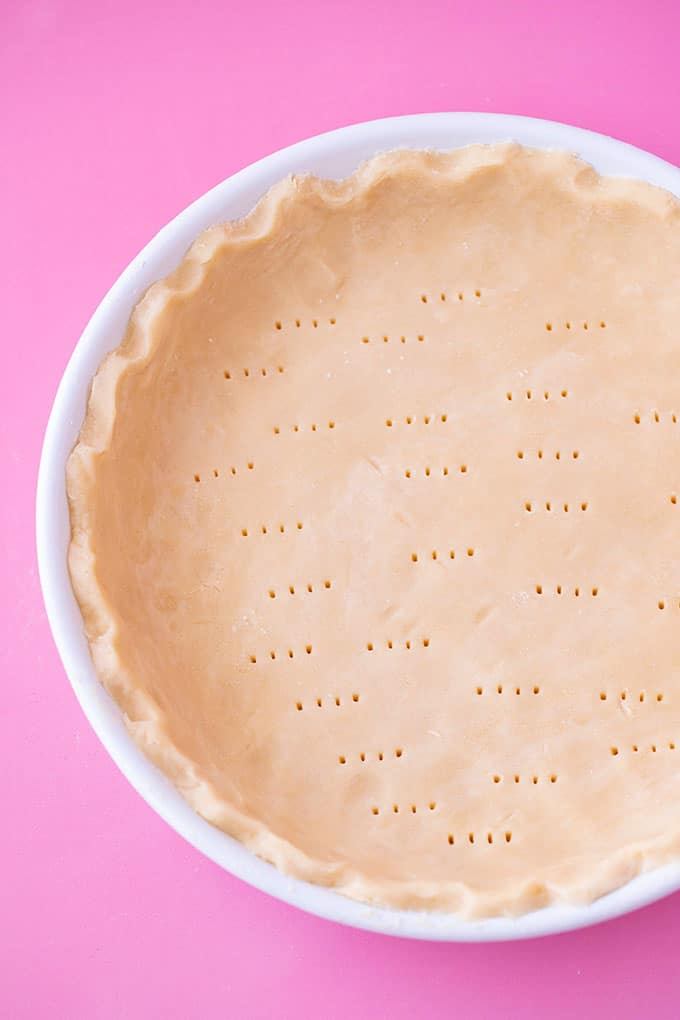 A pie plate with shortcrust pastry before it's baked