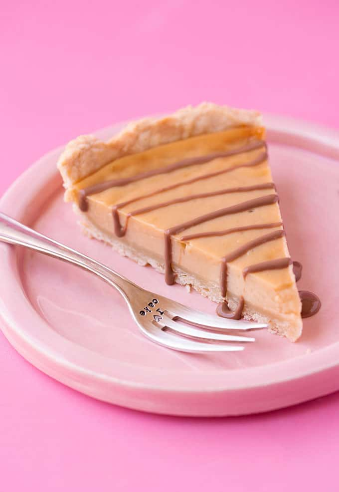 A slice of Honey Pie drizzled with chocolate