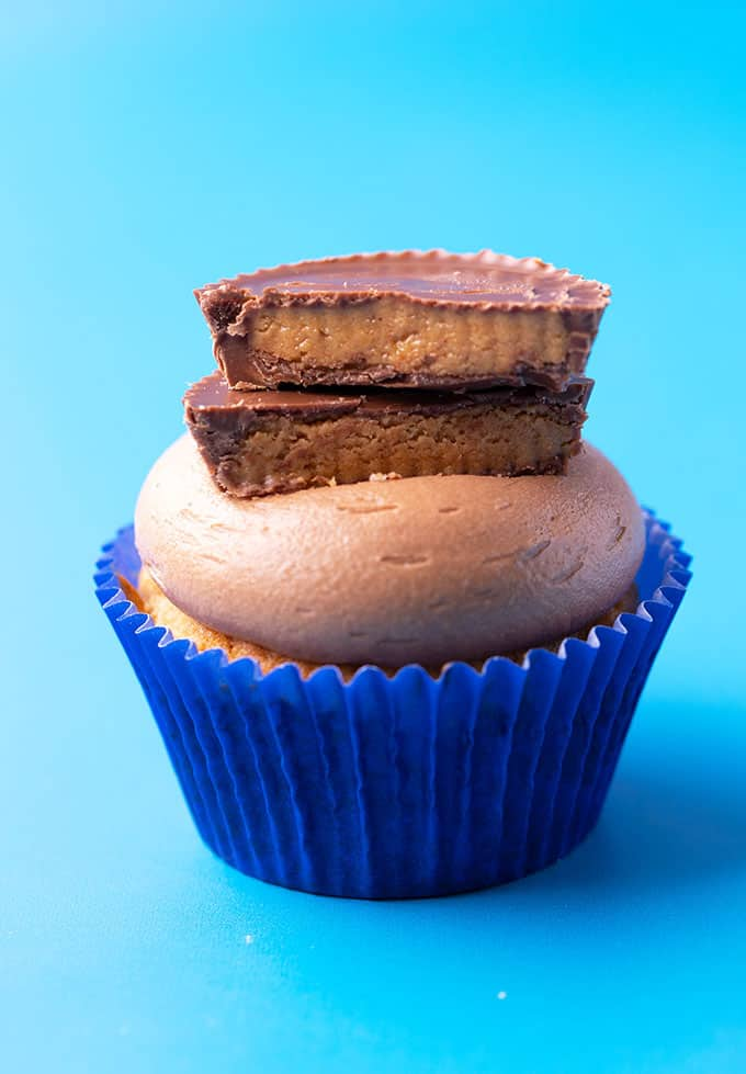 A homemade peanut butter cupcake on a blue background