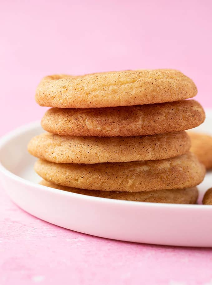 A tall stack of Snickerdoodle Cookies on a white plate