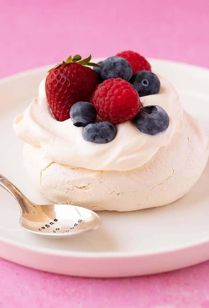A homemade Mini Pavlova on a white plate