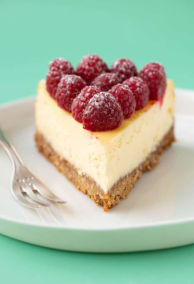 Close up of a slice of White Chocolate Cheesecake served with a small cake fork