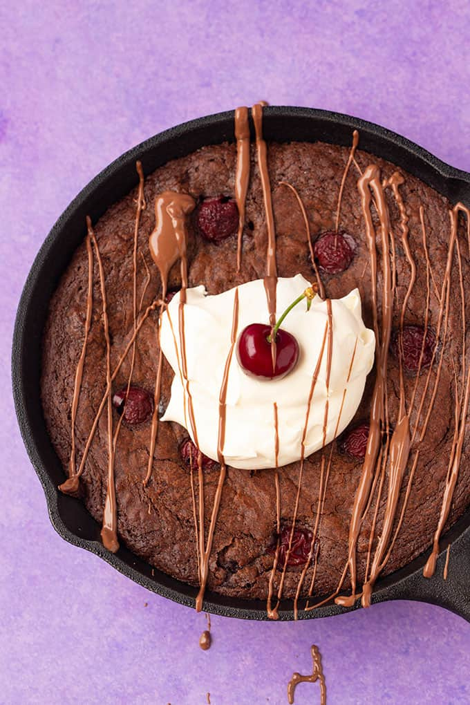 Top view of a Black Forest Skillet Brownie topped with whipped cream