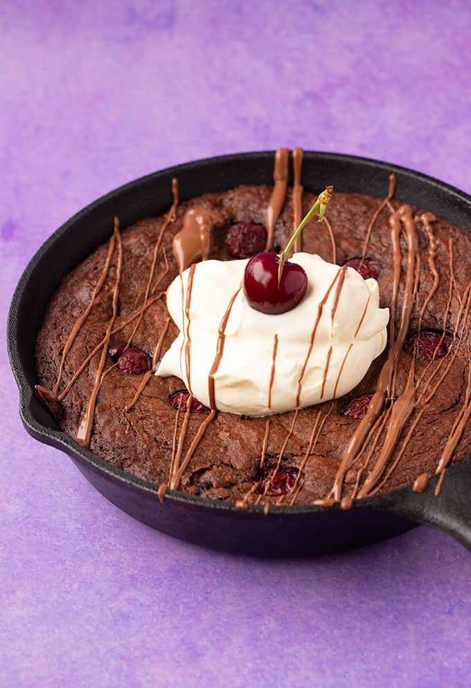 Black Forest Skillet Brownie drizzled with chocolate