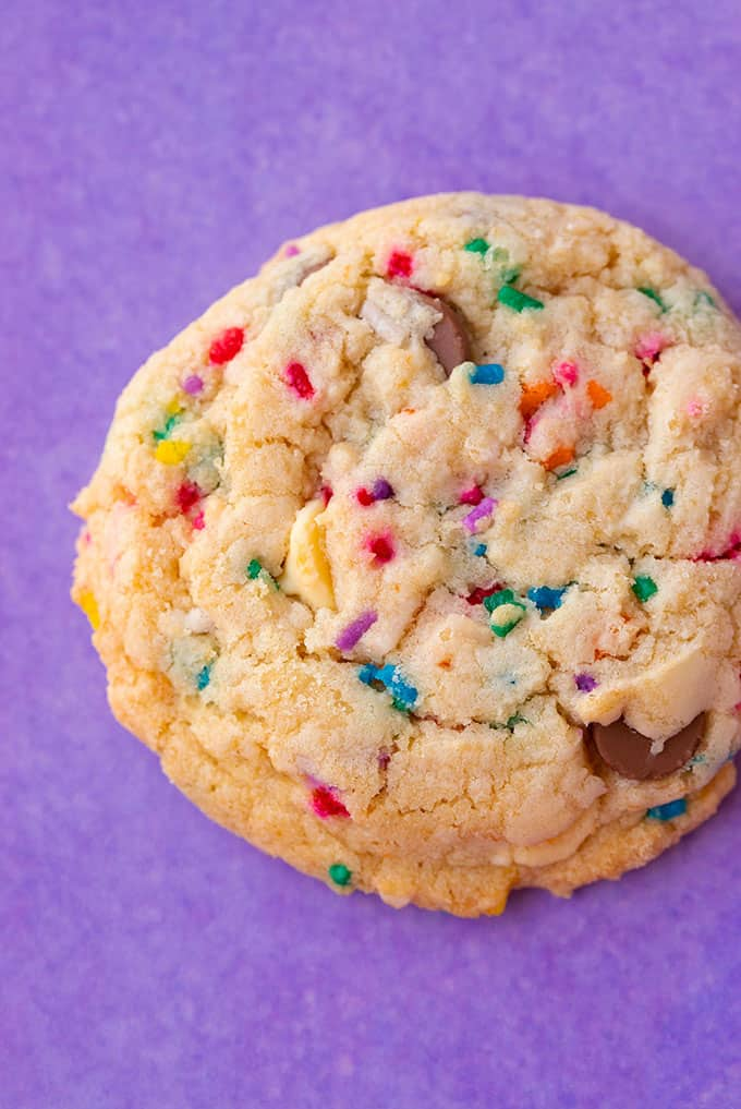 Close up of a homemade Cake Mix Cookie on a purple backdrop