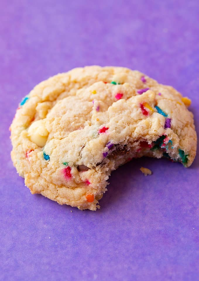 A Cake Batter Cookie with a bite taken out of it