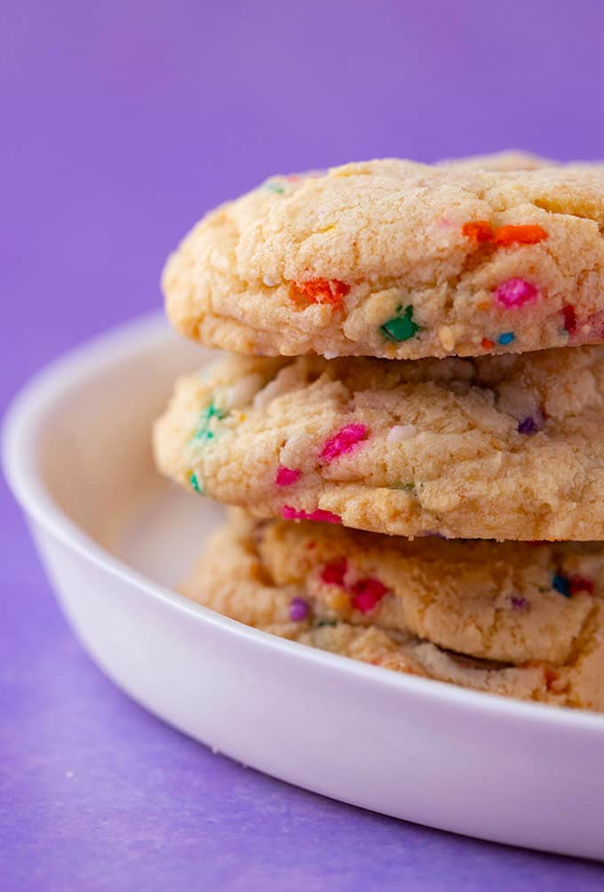 A small stack of Cake Mix Cookies on a white plate