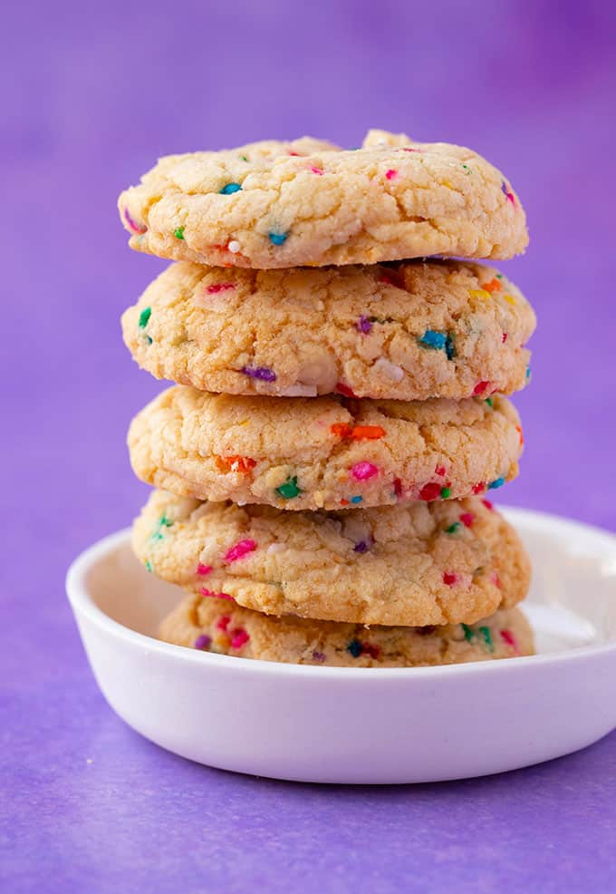 A tall stack of Cake Mix Cookies on a white plate