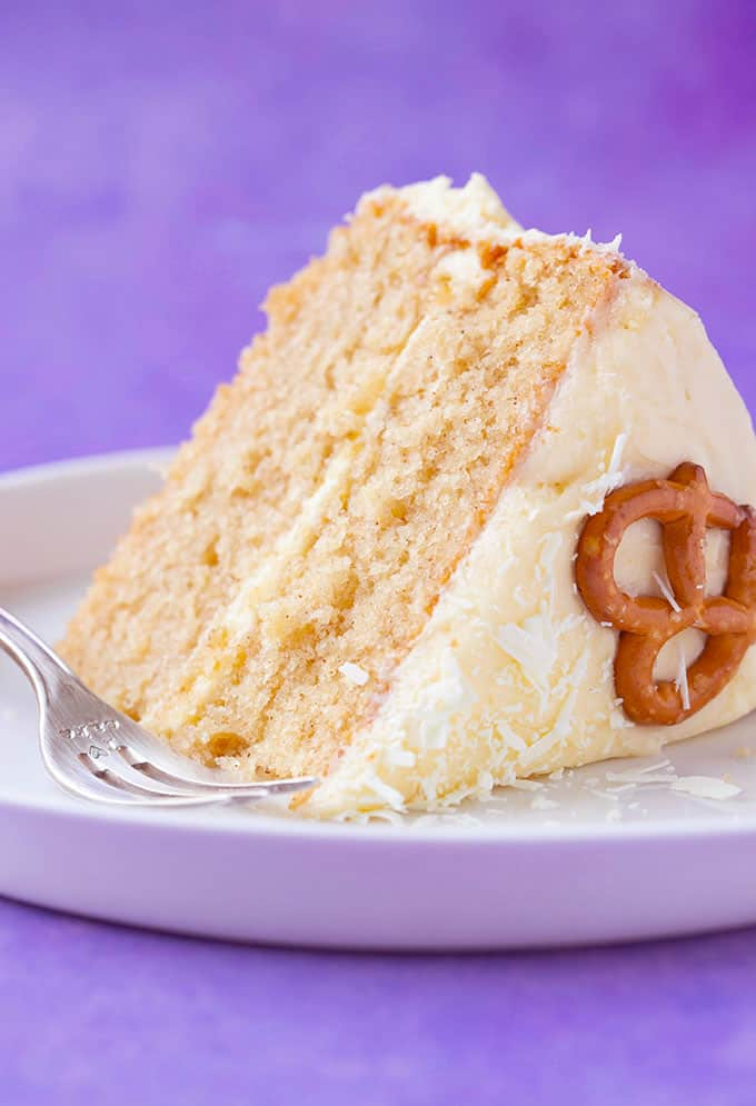 Close up of a slice of Eggnog Cake on a purple background