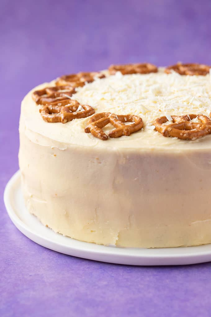 Close up of a homemade Eggnog Cake decorated with pretzels