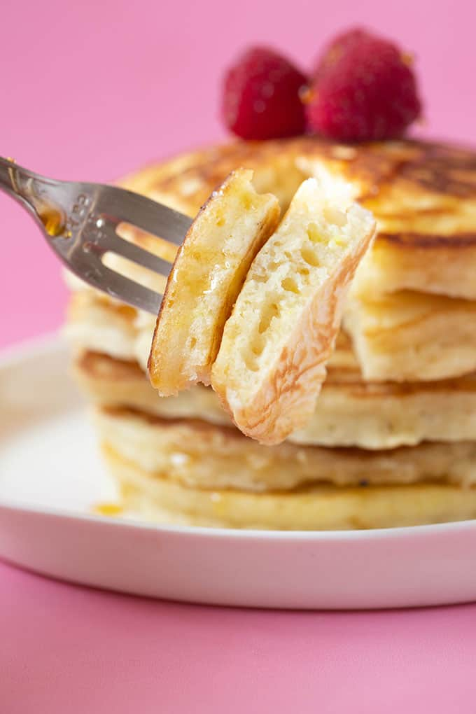 A close up of a fork of pancake