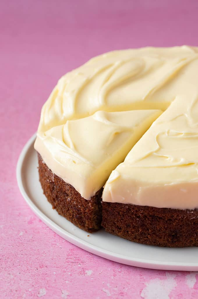 A whole banana cake with swirls of cream cheese frosting