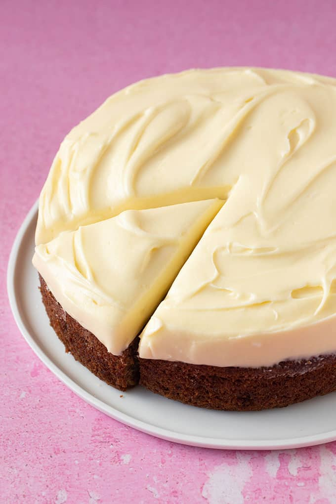 A homemade Banana Cake with a thick layer of cream cheese frosting