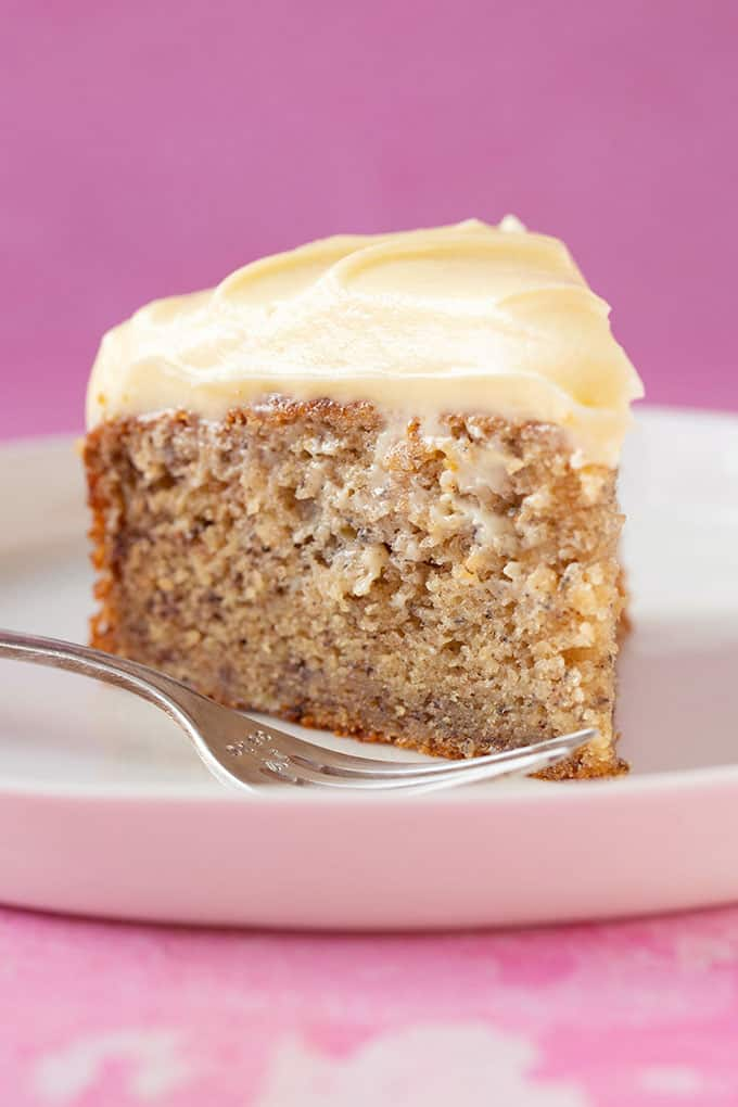 A big slice of Banana Cake with cream cheese frosting