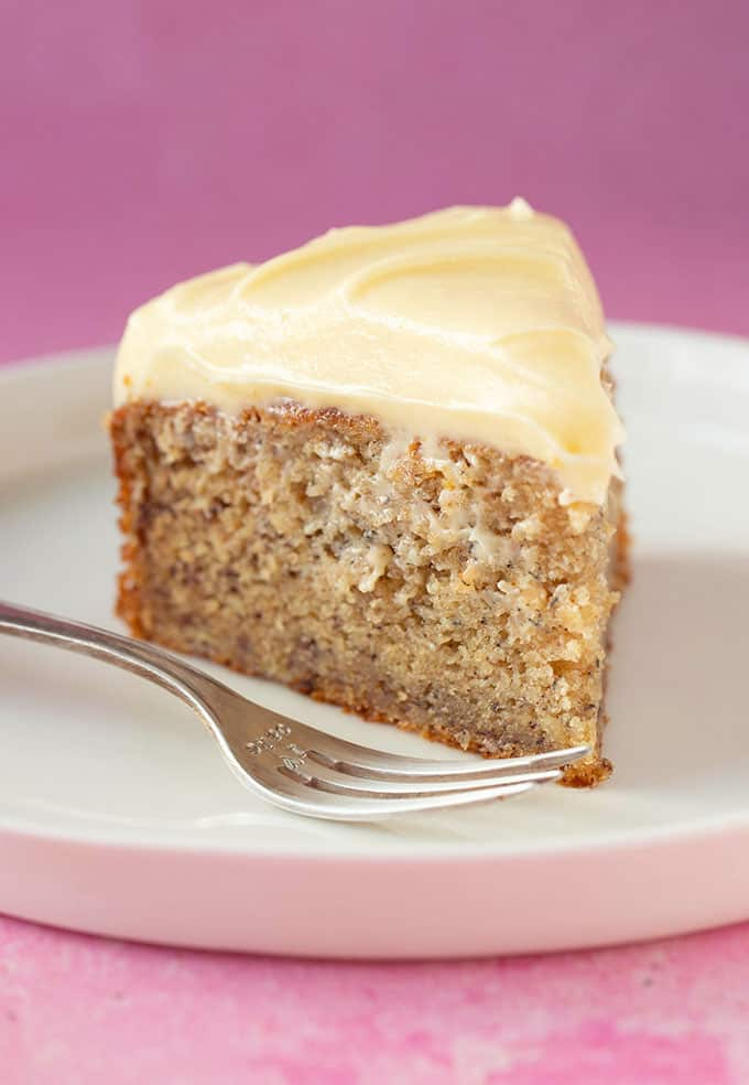 A slice of Banana Cake on a pink background