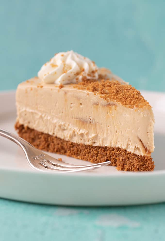 A slice of Biscoff Cheesecake with a fork next to it.