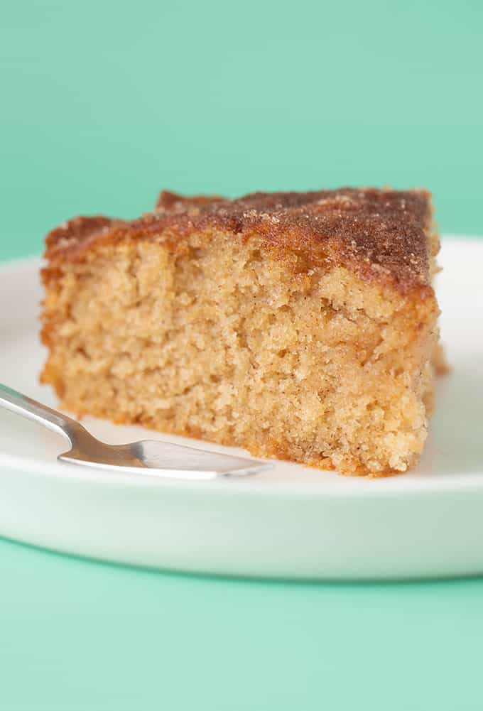 A slice of Cinnamon Tea Cake on a white plate