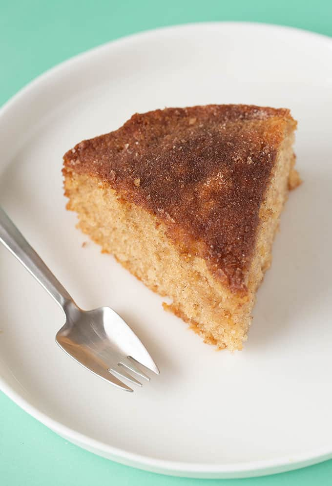 Top view of a slice of Cinnamon Tea Cake on a white plate