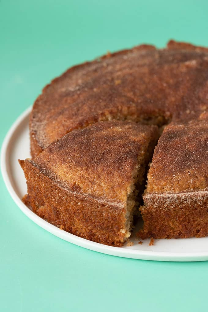 A homemade Cinnamon Tea Cake with a green background