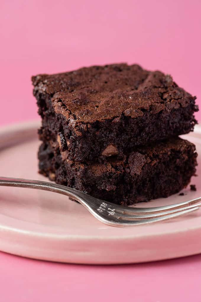 Close up of homemade Flourless Brownies on a pink plate