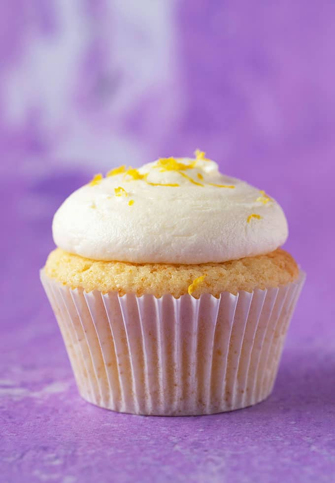 Close up of a homemade Lemon Cupcakes on a purple background