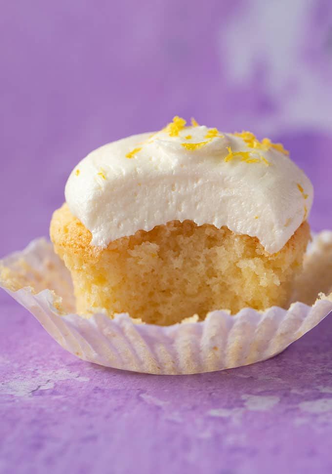 A Lemon Cupcake with a bite taken out of it