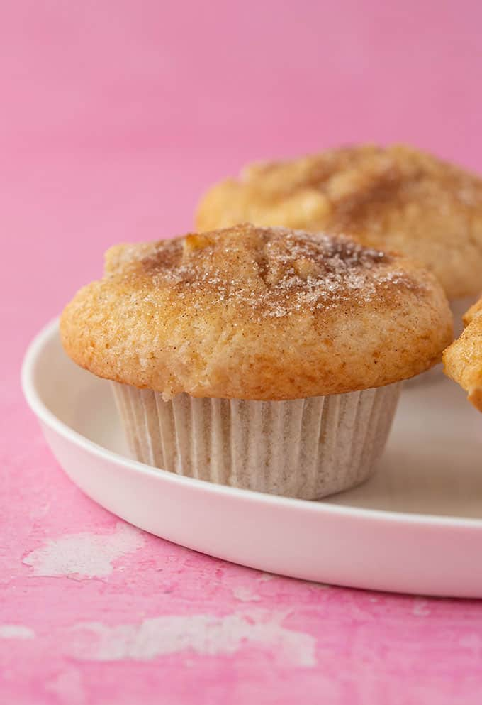 Homemade bakery style muffins on a white plate