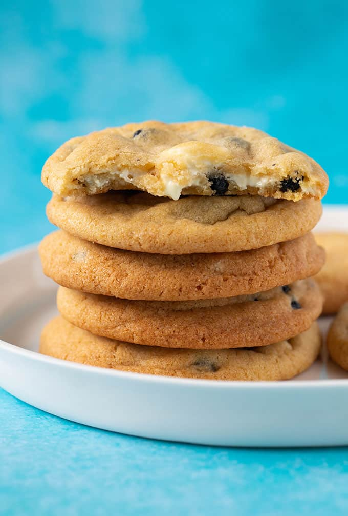 A stack of Blueberry Cookies with a bite taken out of it